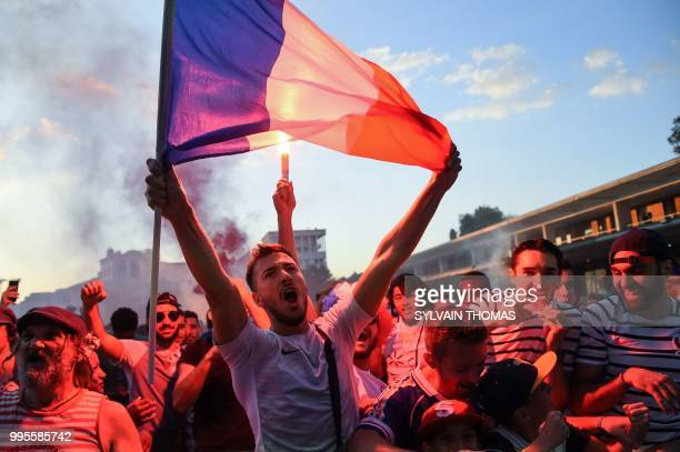 TOPSHOT People celebrate France's first goal as they gather at a fan zone in Montpellier southern France on July 10 2018 to watch the Russia 2018...