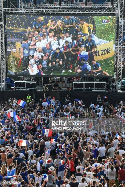 People celebrate France's victory in the Russia 2018 World Cup final football match between France and Croatia on July 15 2018 at the Chaban Delmas...