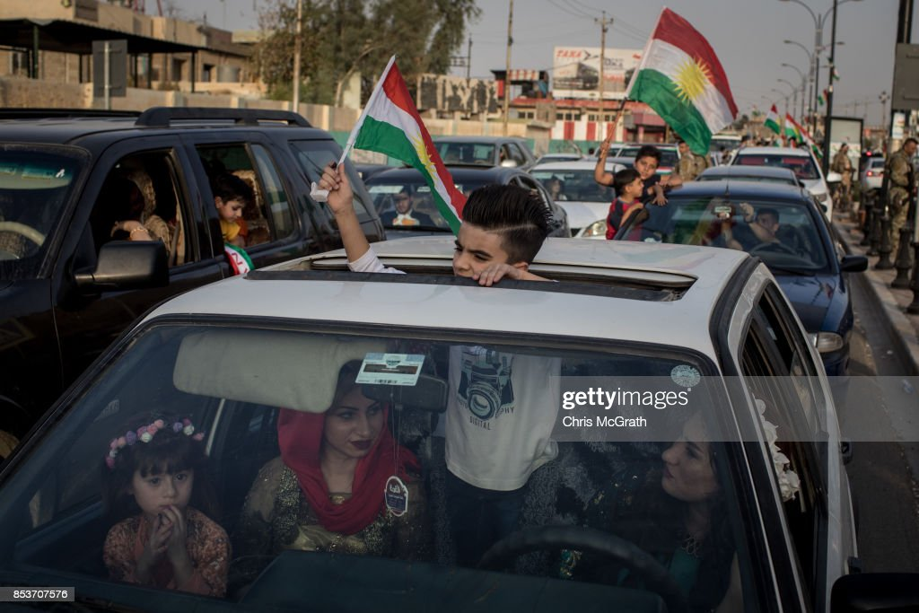 People celebrate from their cars after voting in the Kurdistan independence referendum on September 25, 2017 in Kirkuk, Iraq. Despite strong objection from neighboring countries and the Iraqi government, some five million Kurds took to the polls today across three provinces in the historic independence referendum.