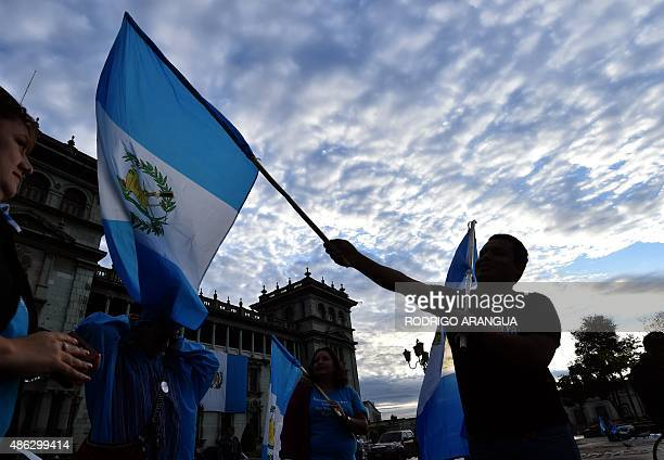 People celebrate Guatemalan President Otto Perez Molina resignation in front of the Presidential Palace in Guatemala City on September 3 2015...