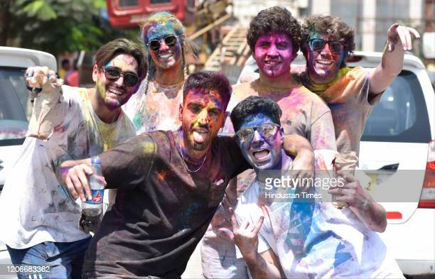 People celebrate Holi featival with colours at Juhu on March 10 2020 in Mumbai India