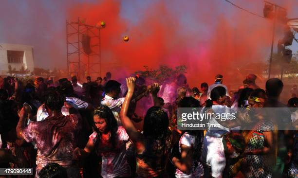 People celebrate Holi festival with colours on March 16 2014 in Indore India The festival falls on the last full moon day of Falgun according to...