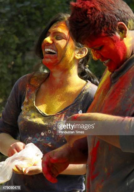 People celebrate Holi festival with colours on March 16 2014 in Gurgaon India The festival falls on the last full moon day of Falgun according to...