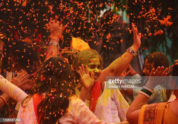 People celebrate Holi the spring festival of colours during an event origanized by Trishla Foundation a nonprofit organisation for cerebral palsy...