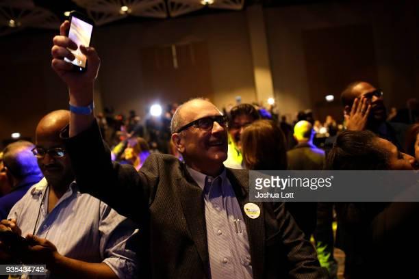 People celebrate Illinois Democratic candidate for governor JB Pritzker's primary win during his election night event on March 20 2018 in Chicago...