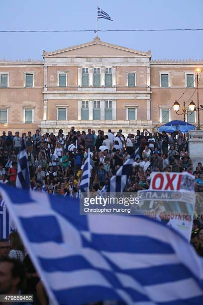 People celebrate in front of the Greek parliament as early opinion polls predict a win for the Oxi or No campaign in the Greek austerity referendum...