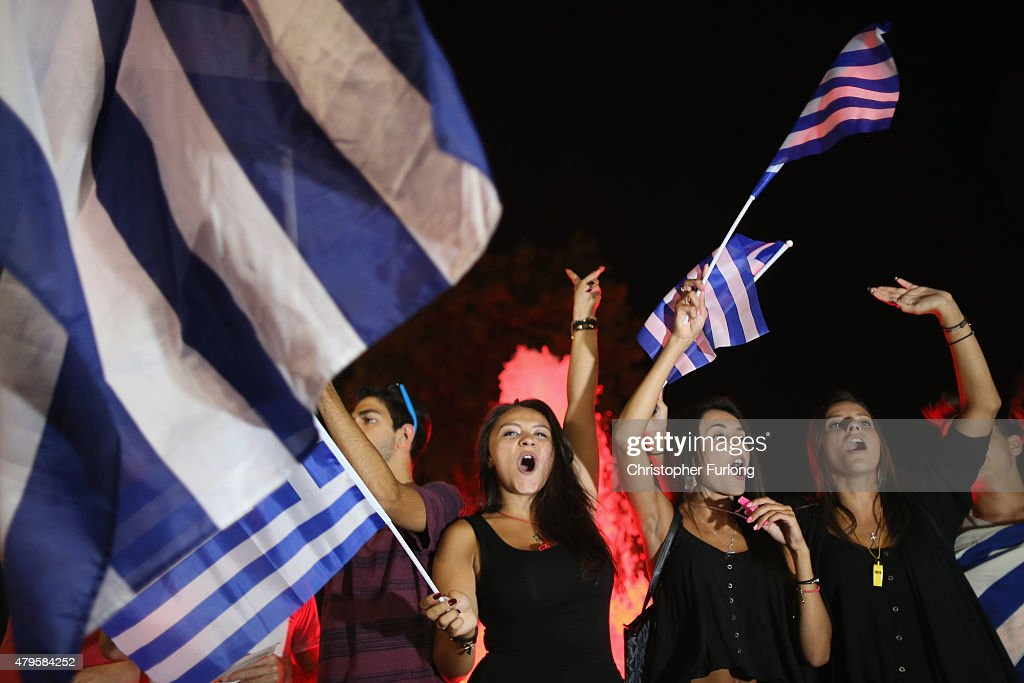 People celebrate in front of the Greek parliament as the people of Greece reject the debt bailout by creditors on July 6, 2015 in Athens, Greece. The greek people have rejected a debt bailout in a referendum with nearly 62% voting 'No', against 38% voting 'Yes' according to interior ministry figures