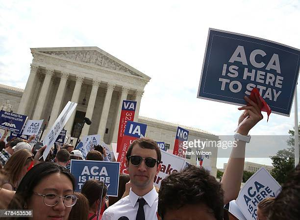 People celebrate in front of the US Supreme Court after ruling was announced on the Affordable Care Act. June 25, 2015 in Washington, DC. The high...