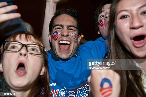 People celebrate in front of the White House in Washington on November 6, 2012. Obama was re-elected late Tuesday, making history when he won a...