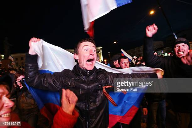 People celebrate in Lenin Square after a day of voting on March 16, 2014 in Simferopol, Ukraine. Crimean's went to the polls today in a vote that...