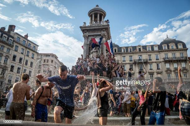 People celebrate in Lyon France on July 15 2018 Thousands of people marched through the streets of the city to express their joy after the victory of...