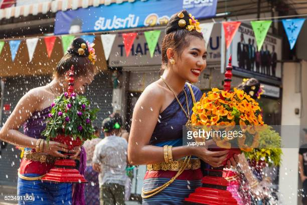 people celebrate in songkran festival day - chiang mai province stock photos and pictures