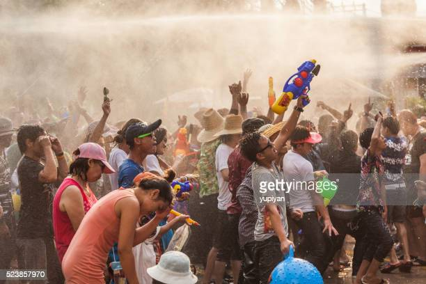 people celebrate in songkran festival day - buddhist new year stock pictures, royalty-free photos & images