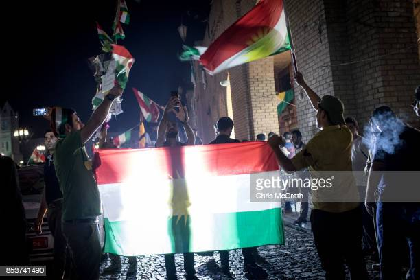 People celebrate in the street after polls closed in the Kurdistan independence referendum on September 25 2017 in Erbil Iraq Despite strong...