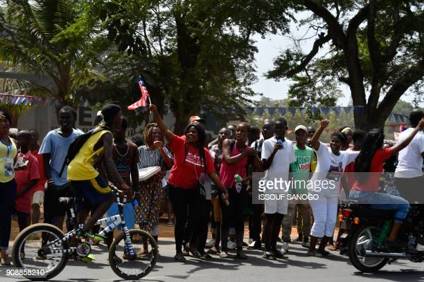 People celebrate in the street after the inauguration of Liberia's new president on January 22 2018 in Monrovia To the cheers of a crowd fired by his...
