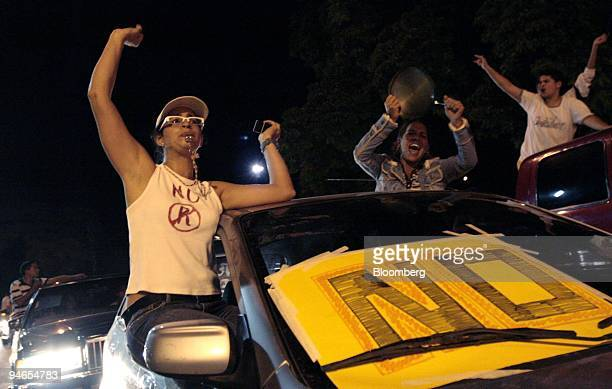 People celebrate in the streets after hearing the results of an election designed to change the country's constitution in Valencia Venezuela on...