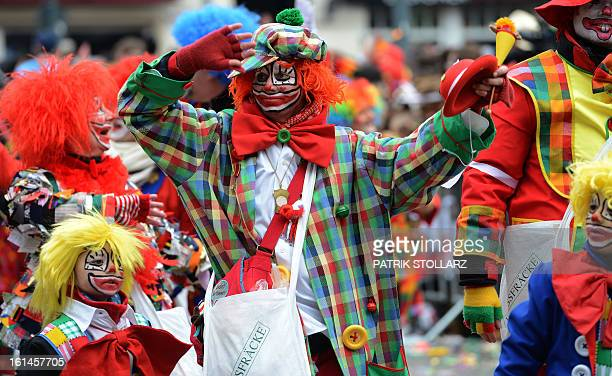 People celebrate in the streets of Duesseldorf during the traditional Rose Monday parade on February 11 2013 Carnival goers mainly in the Rhine...