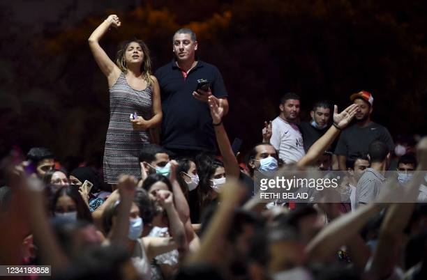 People celebrate in the streets of Tunis after Tunisian President Kais Saied announced the suspension of parliament and the dismissal of the prime...