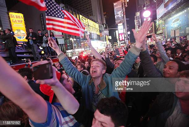 People celebrate in Times Square after the death of accused 911 mastermind Osama bin Laden was announced by US President Barack Obama May 2 2011 in...