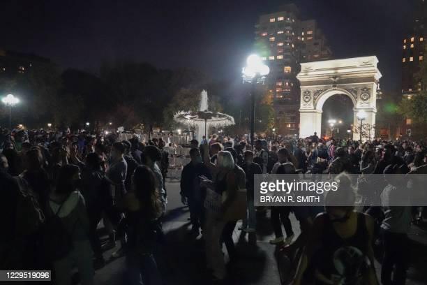 People celebrate in Washington Square Park after Joe Biden was declared the next President on November 7, 2020 in New York. - Democrat Joe Biden has...