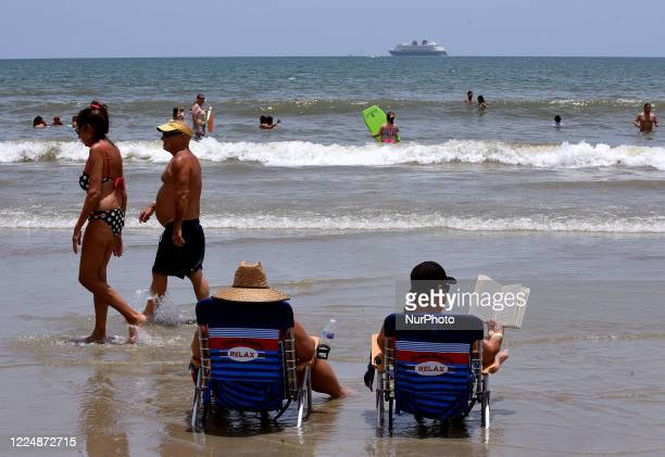 People celebrate Independence Day by reading a book at the beach on July 4, 2020 in Cocoa Beach, Florida. Crowds at the beach were below normal for a...