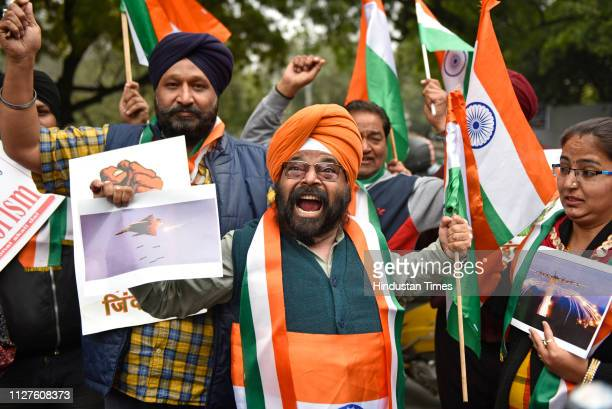 People celebrate Indians airstrike on the JaisheMohammeds biggest camp in Pakistans Balakot town at Jantar Mantar on February 26 2019 in New Delhi...