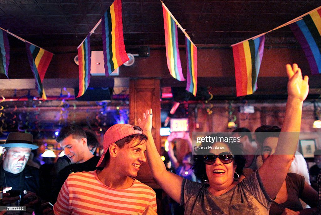 People celebrate inside the Stonewall Inn, an iconic gay bar recently granted historic landmark status, on June 26, 2015 in the West Village neighborhood in New York City. The U.S. Supreme Court ruled that same-sex couples have the right marry in all 50 states.