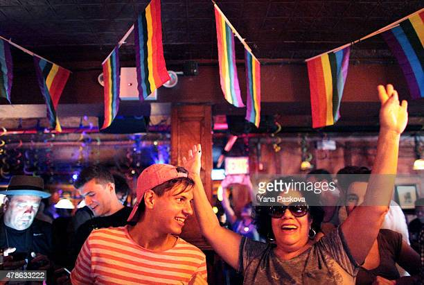 People celebrate inside the Stonewall Inn an iconic gay bar recently granted historic landmark status on June 26 2015 in the West Village...