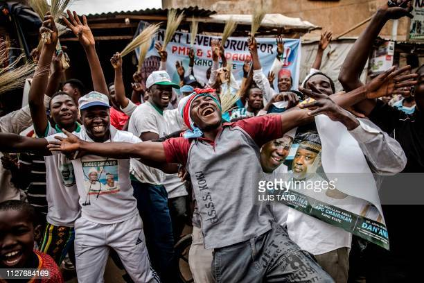 TOPSHOT People celebrate on February 27 2019 in a street of Kano the reelection of Muhammadu Buhari as Nigerian president after a delayed poll that...