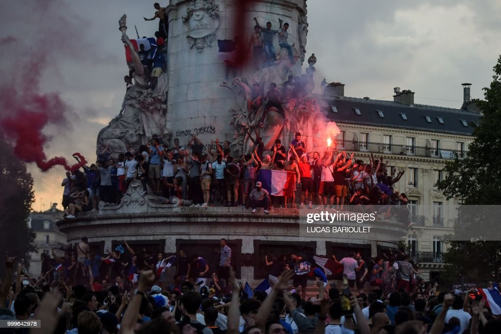 People celebrate on the Place de la Republique (Republic's Square) in Paris on July 15, 2018, after France won the Russia 2018 World Cup final football match between France and Croatia.