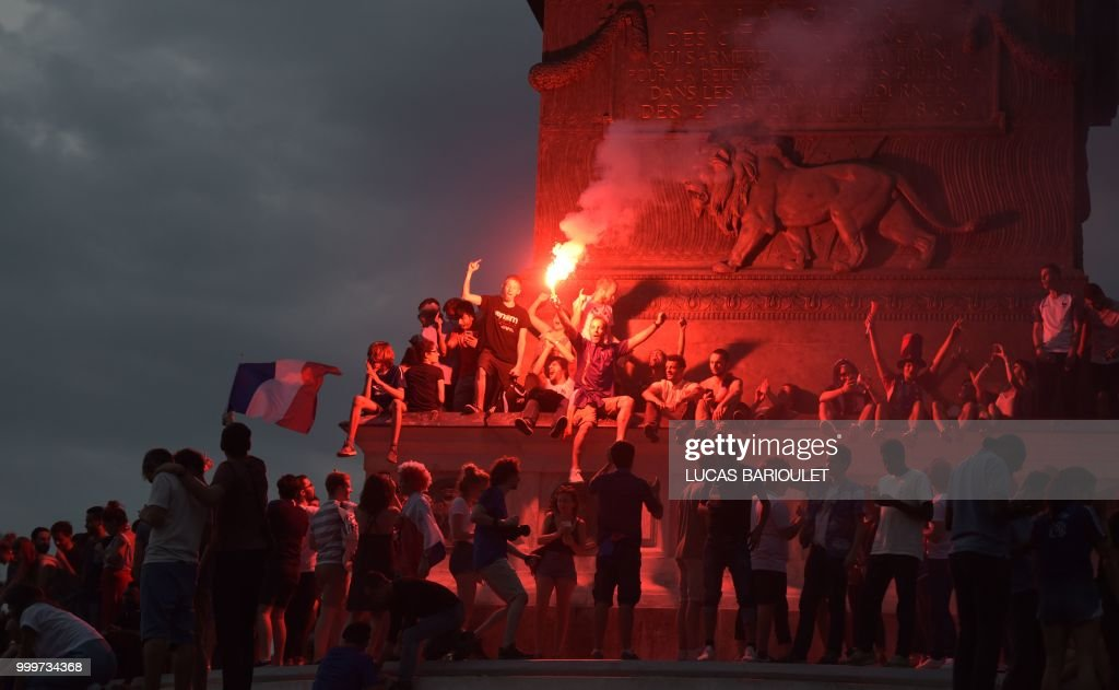 People celebrate on the Place de la Republique (Republic's Square) in Paris on July 15, 2018, after France won the Russia 2018 World Cup final football match against Croatia.
