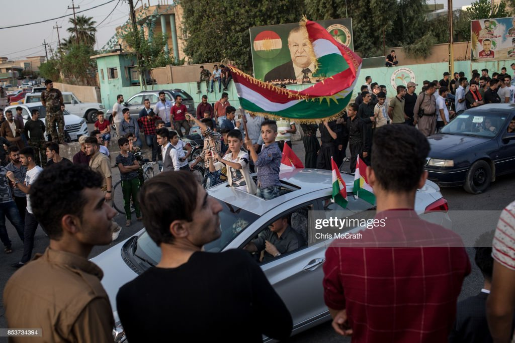 People celebrate on the streets after voting on September 25, 2017 in Kirkuk, Iraq. Despite strong objection from neighboring countries and the Iraqi government, some five million Kurds took to the polls today across three provinces in the historic independence referendum.