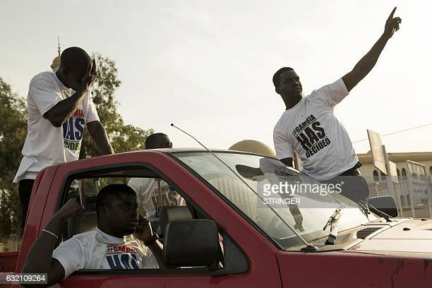 People celebrate on the streets the inauguration of new Gambia's president Adama Barrow in the Pipeline neighbourhood on January 19, 2017 in Banjul,...
