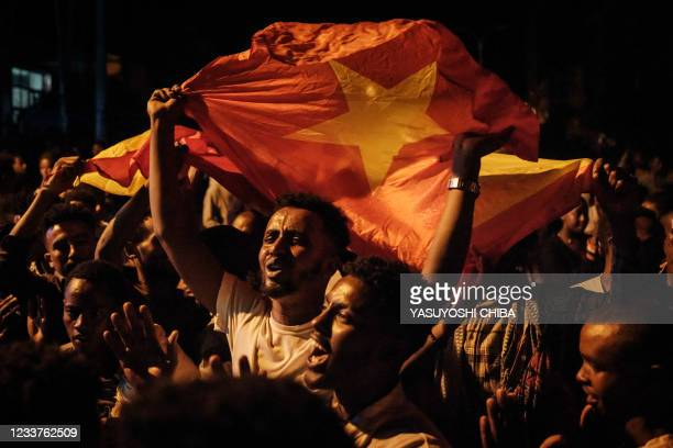 People celebrate the arrival of soldiers of Tigray Defence Force on a street in Mekele, the capital of Tigray region, Ethiopia, on June 28, 2021. -...