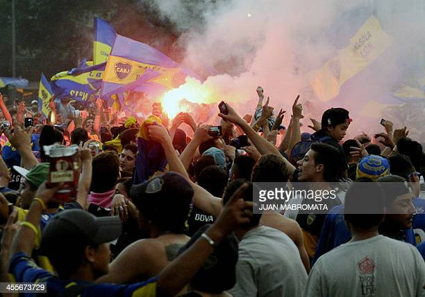 People celebrate the Boca Juniors' fan day at the Plaza de la Republica square in Buenos Aires Argentina on December 12 2013 AFP PHOTO / Juan...