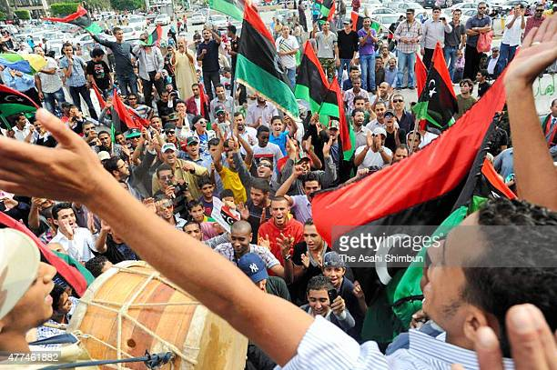 People celebrate the death of Muammar Gaddafi and the release of Sirte during the Libyan Civil War on October 20, 2011 in Tripoli, Libya.
