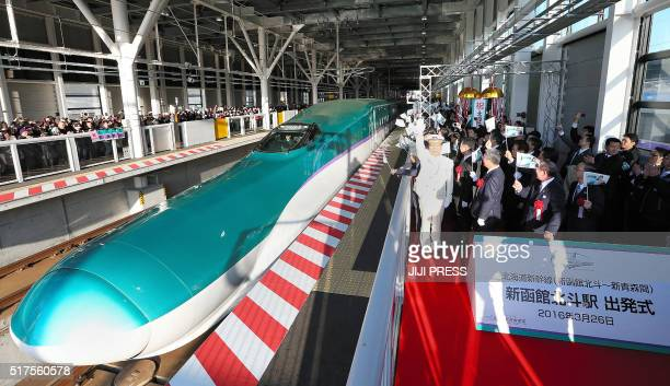 People celebrate the departure of the first shinkansen bullet train at Shinhakodatehokuto station in Hokuto Hokkaido on March 26 2016 Japan commenced...