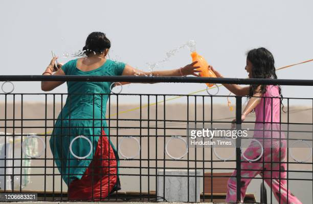 People celebrate the festival of Holi with colours at Sector11 near DAV High School on March 10 2020 in Gurugram India