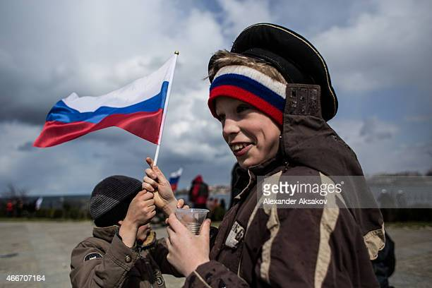 People celebrate the first anniversary of the signing of the decree on the annexation of the Crimea by the Russian Federation on March 18 2015 in...