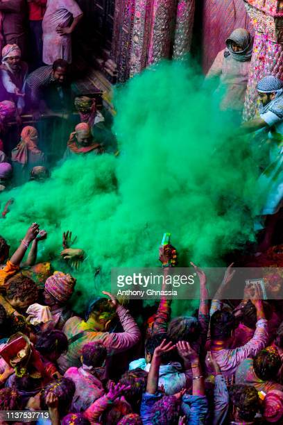 People celebrate the Holi festival and receive green color powder at the Banke Bihari on March 20 2019 in Vrindavan India