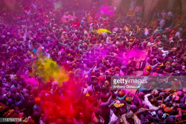 People celebrate the Holi festival at the Banke Bihari Temple on March 20 2019 in Vindavan India