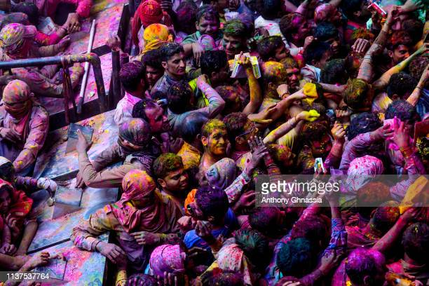 People celebrate the Holi festival at the Banke Bihari Temple on March 20 2019 in Vrindavan India