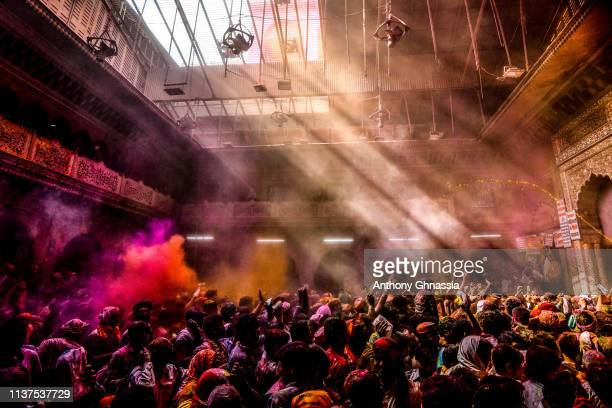People celebrate the Holi festival on March 20 2019 in Vrindavan India