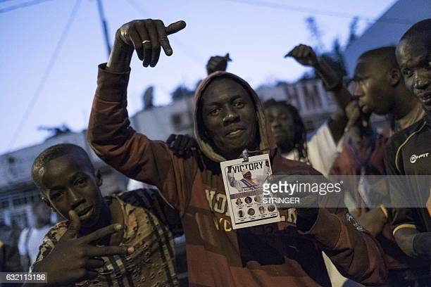 People celebrate the inauguration of new Gambia's President Adama Barrow at Westfield neighbourhood on January 19, 2017 in Banjul. / AFP / STRINGER