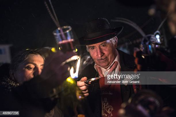 People celebrate the launch of the 2013 vintage of the famous French wine 'Beaujolais Nouveau' during the traditional event 'the Sarmentelles' on...