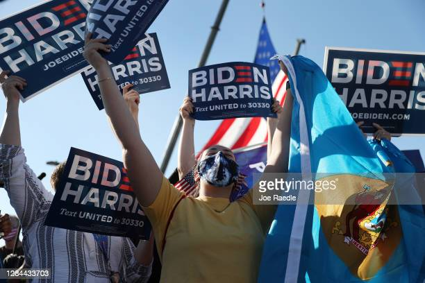 People celebrate the news that Democratic presidential nominee Joe Biden has seemingly won the election while waiting at the Chase Center where Mr....