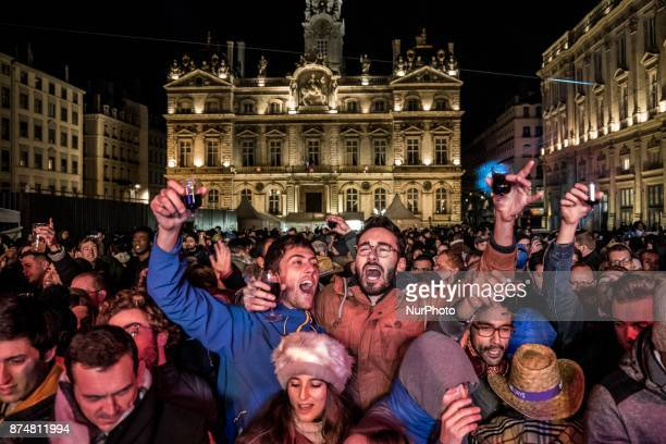 People celebrate the official launch of the Beaujolais Nouveau wine on November 15 2017 in Lyon France The tradition is that the first barrel of wine...