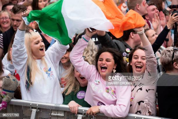 People celebrate the official result of the Irish abortion referendum at Dublin Castle in Dublin on May 26 2018 which showed a landslide decision in...