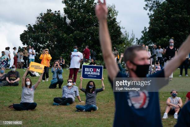 People celebrate the projected presidential win for Democratic nominee Joe Biden at Freedom Park on November 7, 2020 in Atlanta, Georgia. Supporters...
