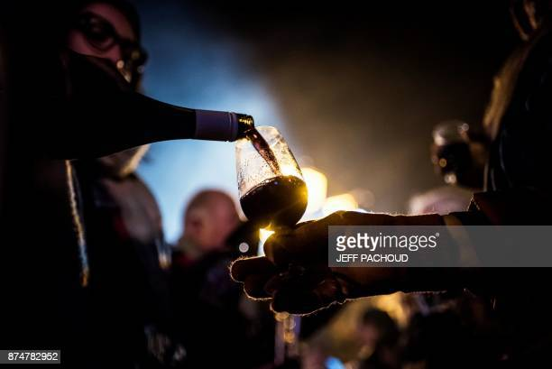 People celebrate the traditional event of the Sarmentelles that starts the Beaujolais Nouveau edition on November 16 2017 on the streets in Beaujeu...